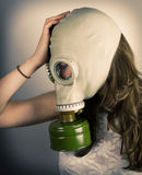 Woman wearing gas mask Royalty Free Stock Photos
