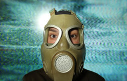 Woman wearing gas mask Stock Photos