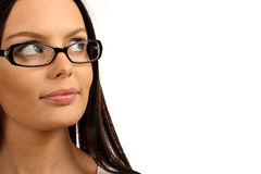 Woman wearing glasses. Cute girl wearing glasses looking at copy space. Isolated over white background Royalty Free Stock Photo