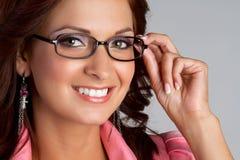Woman Wearing Glasses. Beautiful smiling woman wearing glasses royalty free stock image