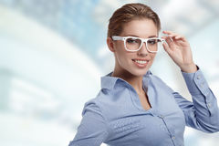 Woman Wearing Glasses in office Royalty Free Stock Image