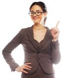 Woman wearing glasses pointing up Stock Photography