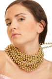 Woman wearing gold necklace Royalty Free Stock Photos