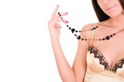Woman wearing gold top and jewellery Stock Photography