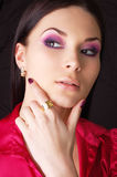 Woman wearing golden earring and ring Royalty Free Stock Photos