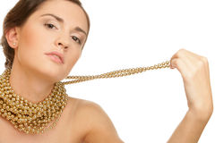 Woman wearing golden necklace Royalty Free Stock Images