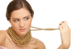 Woman wearing golden necklace Royalty Free Stock Photography