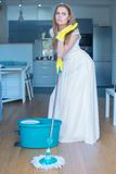Woman Wearing Gown Mopping Floor in Kitchen Royalty Free Stock Photography