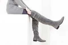 Woman wearing gray boots Royalty Free Stock Images