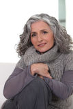 Woman wearing  gray clothing. Inside Stock Photography