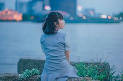 Woman Wearing Gray Dress Sitting Near Body of Water Stock Photos