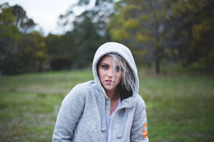 Woman Wearing Gray Hoodie over Green Grass Selective Focus Photography Stock Image