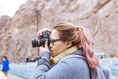 Woman Wearing Gray Jacket Using Black Dslr Camera Stock Image
