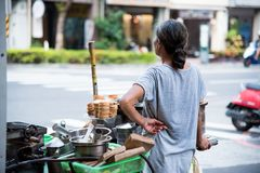 Woman Wearing Gray Shirt Standing Beside Food Cart Stock Photos