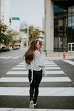 Woman Wearing Gray Sweater Standing on Pedestrial Line Royalty Free Stock Images