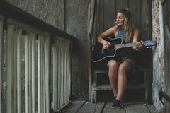Woman Wearing Gray Tank Top Playing Black Cutaway Acoustic Guitar Stock Image