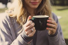 Woman Wearing Gray Zip-up Jacket Holding Ceramic Cup Royalty Free Stock Photo