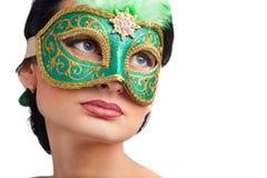 Woman wearing green carnival mask Stock Photo