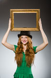 Woman wearing green dress holding Stock Photography