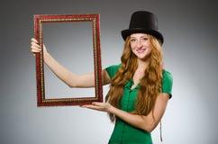 Woman wearing green dress holding Royalty Free Stock Photo
