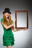 Woman wearing green dress holding Stock Photos