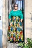 Woman Wearing Green Long-sleeved Shirt and Printed Skirt royalty free stock photos