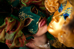 Woman wearing a  green mask, ready to be kissed. Studio shot Royalty Free Stock Images