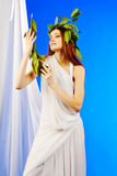Woman wearing green roman laurel wreath Stock Photos