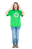 Woman wearing green shirt with recycling symbol screaming. Against white background Royalty Free Stock Images