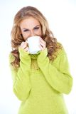 Woman Wearing Green Sweater Drinking from Mug Royalty Free Stock Photo
