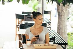 Woman Wearing Grey Shirt Sitting on Chair Stock Photography