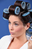 Woman wearing hair curlers Royalty Free Stock Photography