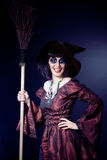Woman wearing halloween witch costume Stock Images