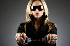 Woman wearing handcuffs Royalty Free Stock Images