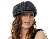 Woman wearing a hat. Portrait of a pretty young woman aganst a white background Stock Image