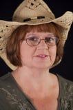 Woman Wearing Hat. Mature woman wearing a cowboy hat Royalty Free Stock Photo