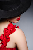 Woman wearing hat against dark background Royalty Free Stock Photography