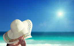 Woman wearing hat and beach Royalty Free Stock Photo