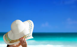 Woman wearing hat and beach Stock Image