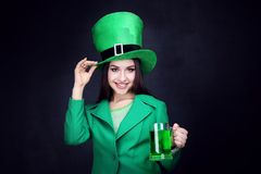 Woman wearing hat with beer. St. Patrick`s Day. Beautiful woman wearing green hat with beer royalty free stock photography