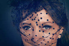Woman wearing a hat with black veil with dots Stock Photography