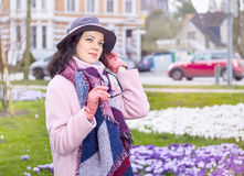 Woman wearing hat in the city street Stock Images