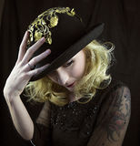 Woman wearing hat with gold trim Stock Photography