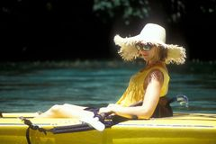 Woman Wearing Hat in Kayak Royalty Free Stock Images