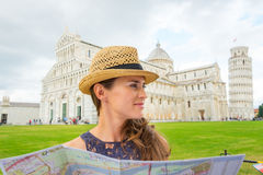 Woman wearing hat in profile holding map in Pisa Stock Photos