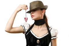 Woman wearing hat showing heart shaped pendent Stock Photos