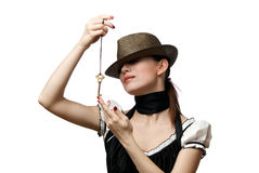 Woman wearing hat showing key shaped pendent Royalty Free Stock Image