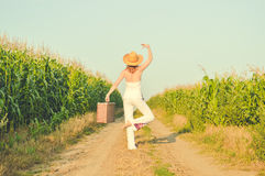 Woman wearing hat standing in ballet pose on Royalty Free Stock Photography