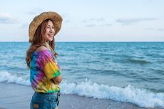 Woman wearing hat standing on sea beach royalty free stock photography