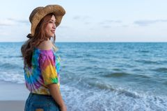 Woman wearing hat standing on sea beach. Woman wearing hat standing on the sea beach royalty free stock photo